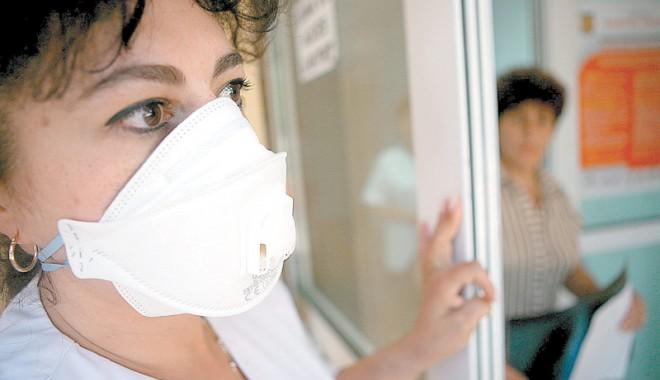 Foto: Două persoane au murit de gripă porcină