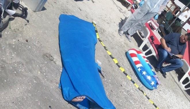 Galerie Foto - DUBLĂ tragedie pe litoral! Tată și fiică luați de valurile mării, decedați după zeci de minute de resuscitare - 10544846792610670769970147055953-1406716893.jpg