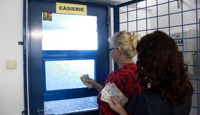Foto: Cum pot fi determinaţi restanţierii să plătească întreţinerea