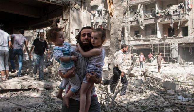 Foto: EXPLOZIE PUTERNICĂ. Peste 100 de civili au fost ucişi