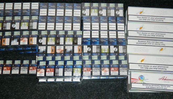Foto: 500 de pachete de ţigări netimbrate, confiscate  de jandarmi