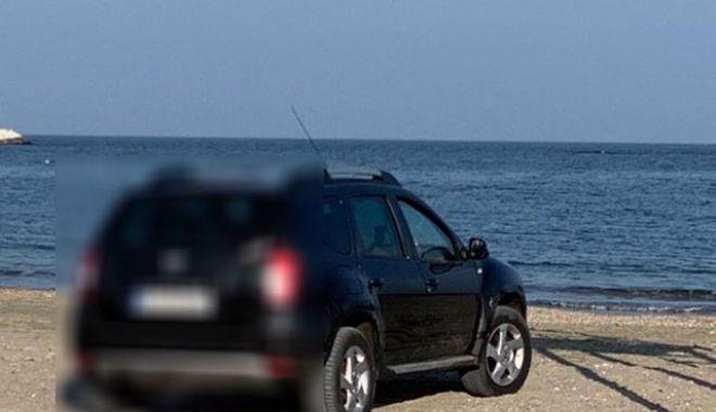 Galerie foto! Amendă usturătoare, pentru un şofer prins cu maşina pe plaja Trei Papuci - 52082350537234936784993541128617-1549877792.jpg