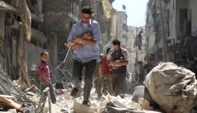 Foto: Mai multe avioane neidentificate au bombardat orașul sirian unde a avut loc presupusul atac chimic