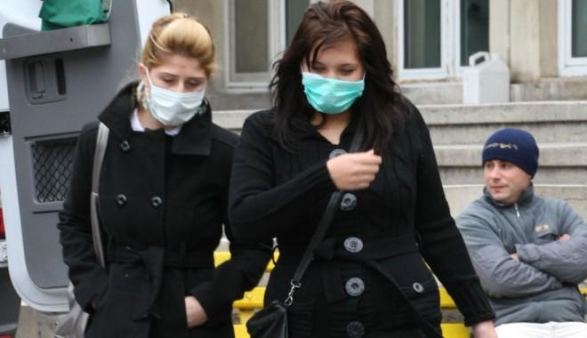 Foto: Gripa porcină a mai luat o viață! O fetiță de șapte ani A MURIT la spital