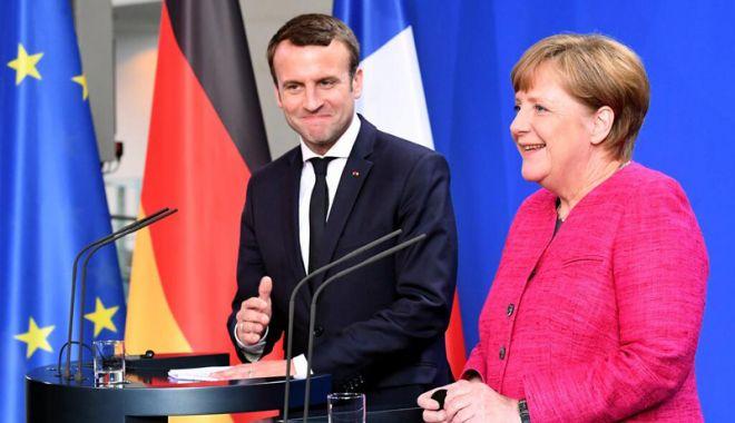 Foto: Angela Merkel, criticată  pentru acordul cu Emmanuel Macron