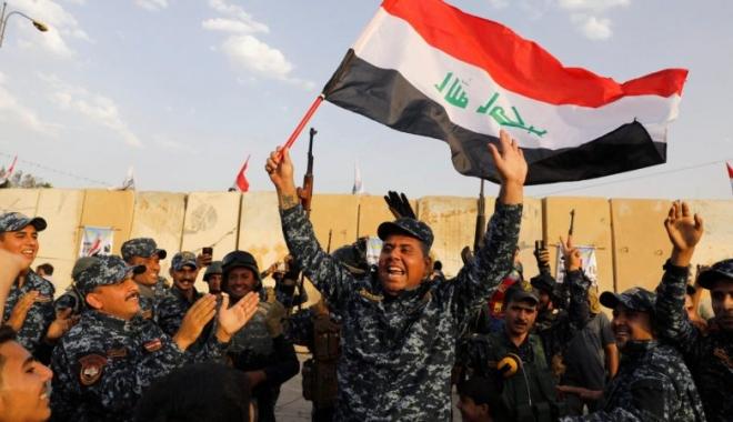 Foto: Armata irakiană a defilat pe străzile Bagdadului, pentru a sărbători victoria asupra ISIS