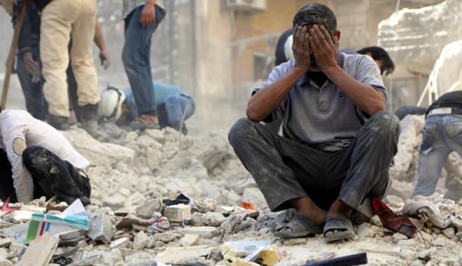 Foto: Carnagiu în Siria. Sunt 112 persoane decedate!