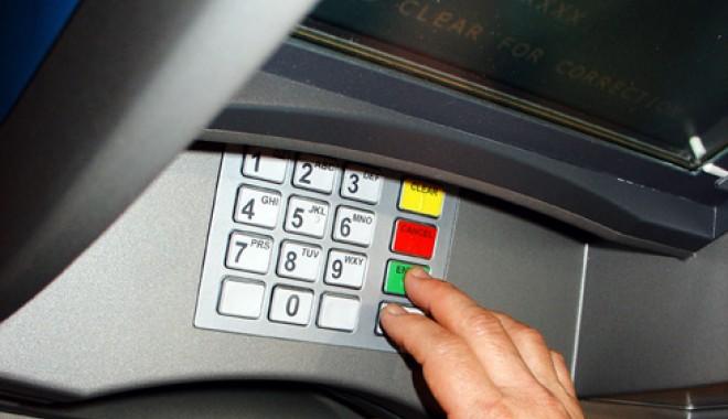 """Foto: 90% din furturile de la bancomatele din Anglia sunt """"opera"""" românilor"""