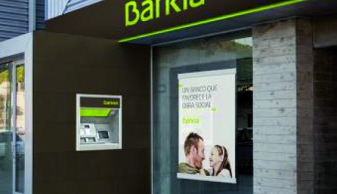 Foto: Clienţii băncii spaniole Bankia au retras un miliard de euro într-o săptămână