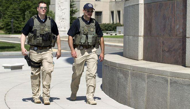 Un bărbat înarmat a încercat să intre în sediul CIA. A fost împușcat de agenți FBI - barbatimpuscat-1620143940.jpg