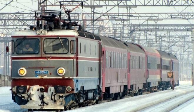 Foto: Cum se călătoreşte  cu trenul,  în condiţii de iarnă