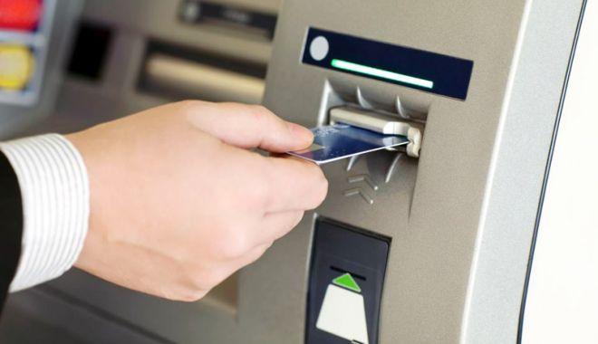 Foto: Clienții băncilor vor plăti mai puține comisioane bancare