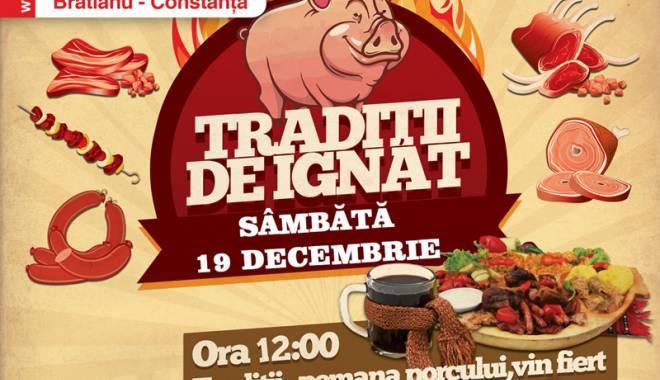 Foto: Cora îi invită pe constănţeni la pomana porcului