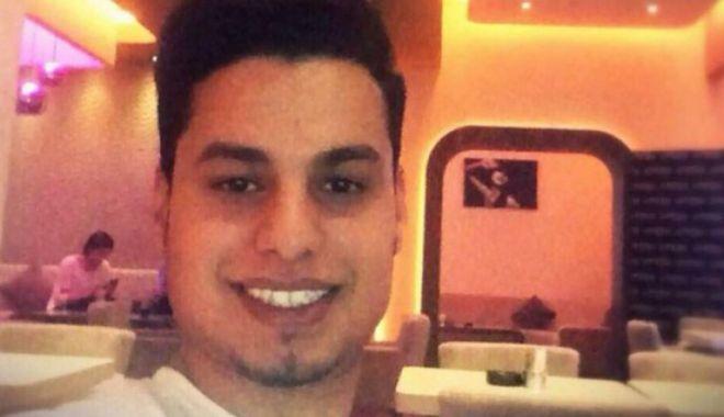 Foto: Libianul care şi-a ucis iubita şi un vecin, agresiv şi în arest. A muşcat un poliţist