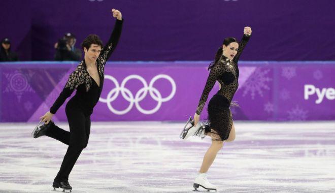 Foto: Trăiri intense în proba de dans pe gheaţă. Aur pentru perechea canadiană Virtue/Moir