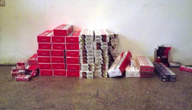 Foto: CAPTURĂ DE ZECI DE MII DE PACHETE DE ŢIGĂRI, LA CONSTANŢA. Contrabandişti prinşi în flagrant, într-un centru comercial