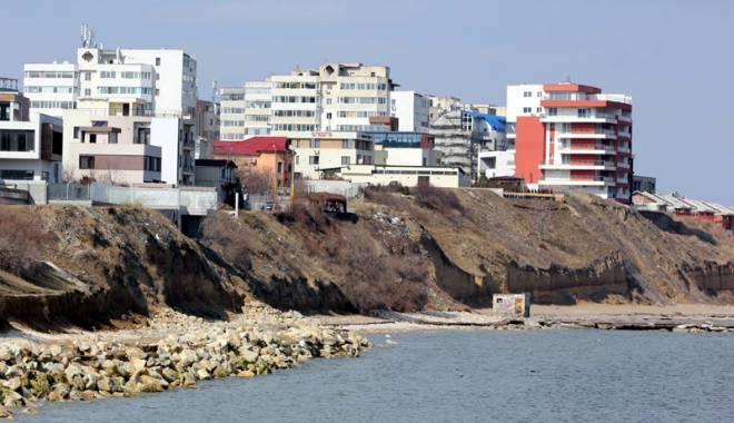 Spectaculos. Plaja Tataia a renăscut la Constanţa - fotofondplajatataiainainte-1440435328.jpg
