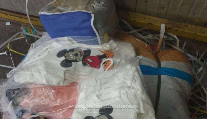 VIDEO. Haine contrafăcute în valoare de un milion de euro, confiscate de poliţiştii de frontieră - haine-1623655755.jpg