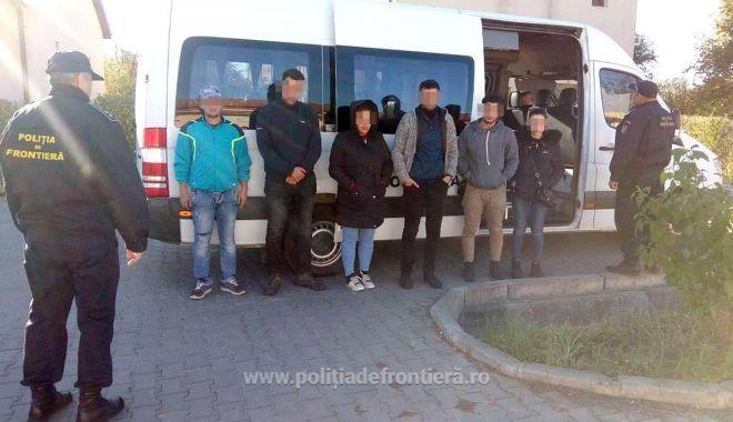 Foto: Două călăuze, reținute de poliţiştii români pentru trafic de migranți