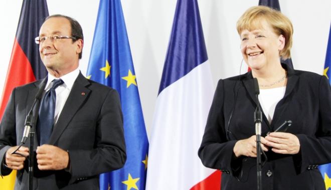 """Foto: Hollande şi Merkel: Dineu de adio şi """"amical"""" la Berlin"""