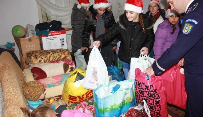 Foto: Campanie CUGET LIBER: Moş Crăciun a adus daruri la mai multe familii din Medgidia / Galerie foto