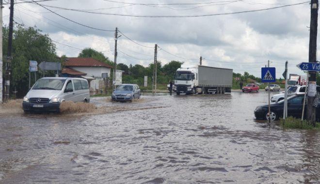 Inundațiile au făcut prăpăd în mai multe zone din țară - inundatii-1623821686.jpg