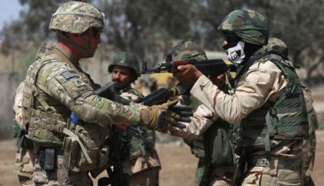 Foto: ZECI DE EXECUŢII! Militarii antrenați de forțele americane au dat lovitura