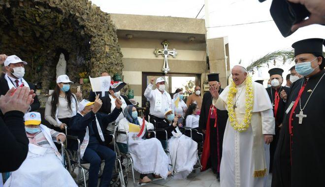 GALERIE FOTO / Cum a fost întâmpinat Papa Francisc în Irak - jmhhc2g9njzhndlizdc0mji3yja2mmi4-1615018075.jpg