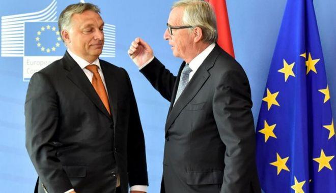 Foto: Juncker îl acuză pe Viktor Orban că desfăşoară campanii  de dezinformare