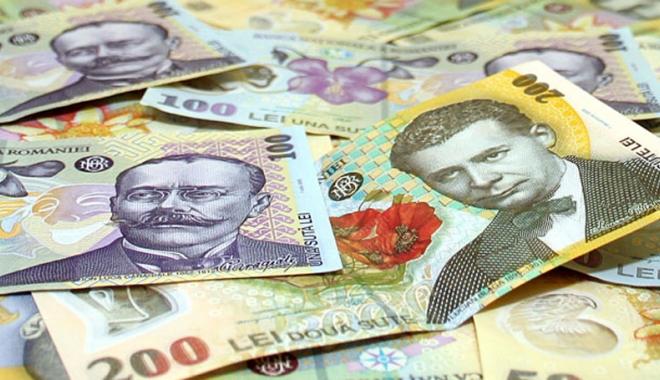 Foto: Leul a câştigat la dolar şi francul elveţian