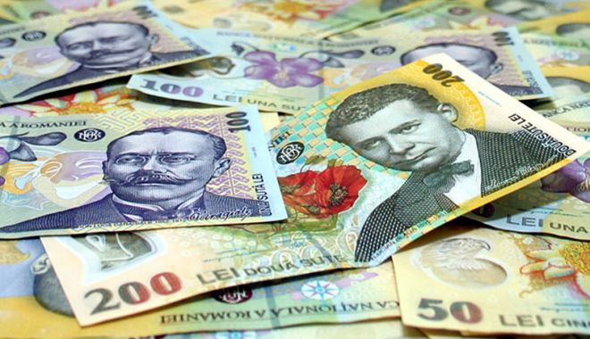 Foto: Leul rupe din euro și dolar, dar pierde la franc