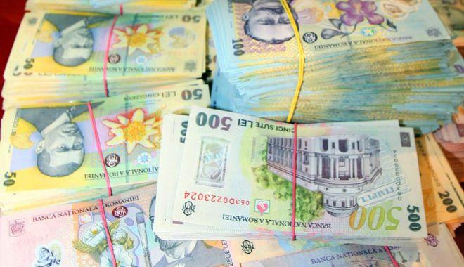 Leul pierde la euro și dolar, dar câștigă la francul elvețian - leul-1547216344.jpg