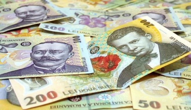 Leul pierde la euro și dolar, dar câștigă la francul elvețian - leul-1612464242.jpg