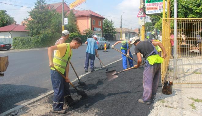 Foto: Lucrătorii români îşi vor primi raţia naţională de speranţă
