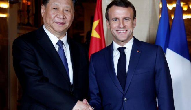 Foto: Macron, Merkel şi Juncker încearcă să demonstreze unitatea europeană în faţa Chinei