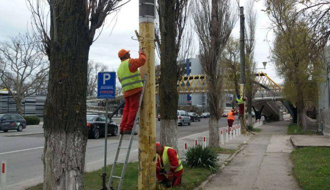 Foto: GALERIE FOTO / Curăţenie de primăvară în staţiunea Mamaia! Se asfaltează şi se vopsesc stâlpii
