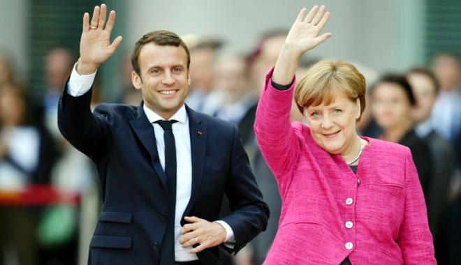 Foto: Merkel şi Macron, dispuşi să schimbe tratatele  ca parte a modernizării Uniunii Europene