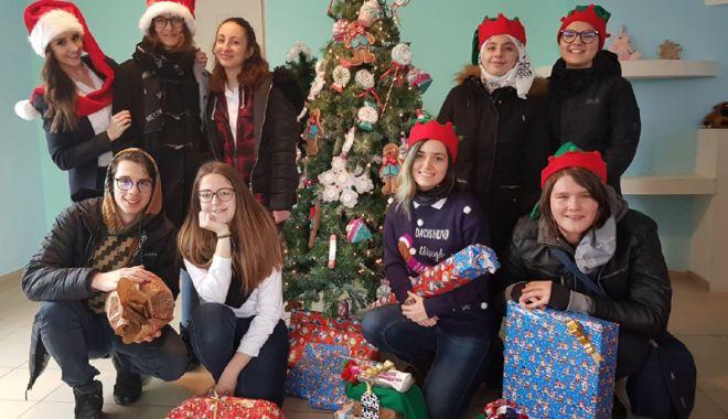 Moș Crăciun pentru o zi, pentru copiii  din Centrul