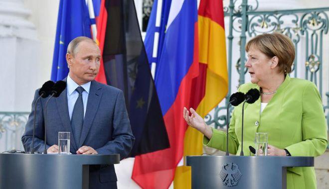 Foto: Niciun acord la primul summit Merkel - Putin din ultimii patru ani