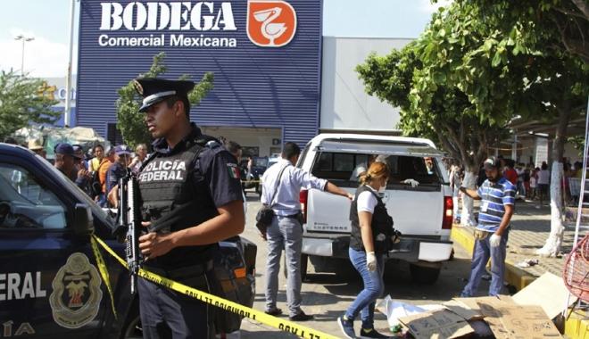 Foto: Schimb de focuri la Acapulco. Turişti morţi şi răniţi