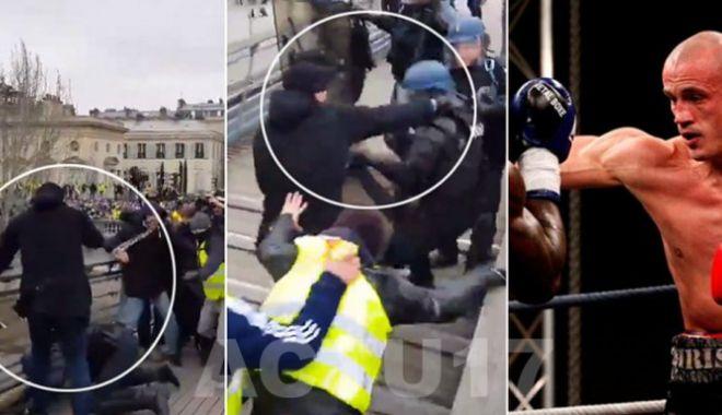 Foto: Violență extremă la Paris. Un boxer profesionist, în fruntea vestelor galbene, lovește jandarmi căzuți