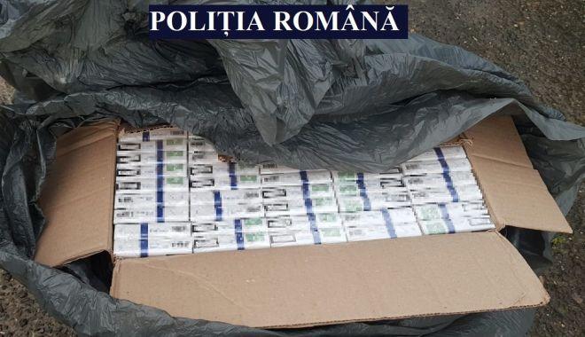 GALERIE FOTO şi VIDEO. Percheziţii şi flagrant delict, la Constanţa, într-un dosar de contrabandă cu ţigări - perchezitii1-1624435770.jpg
