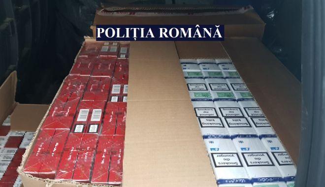 GALERIE FOTO şi VIDEO. Percheziţii şi flagrant delict, la Constanţa, într-un dosar de contrabandă cu ţigări - perchezitii2-1624435788.jpg