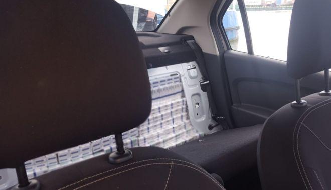 Percheziţii la contrabandiştii de ţigări. Zeci de mii de pachete, confiscate de polițiștii de frontieră - perchezitiitigari1-1560321558.jpg