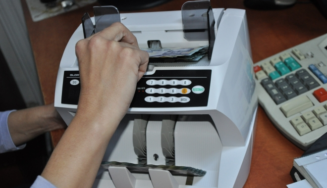 Foto: Poşta Română a cumpărat maşini de numărat bancnote