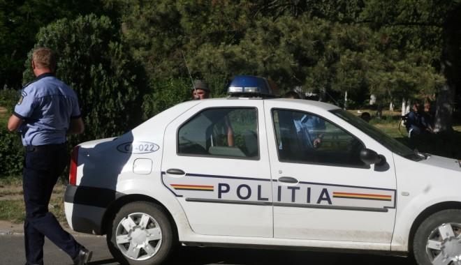 Foto: Reţinut de poliţişti după ce i-a furat unei femei un telefon şi o tabletă