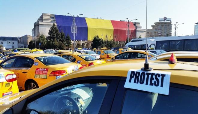 """Foto: Transportatorii ies în stradă! Platforma Uber, acuzată de """"piraterie pe piaţă"""""""