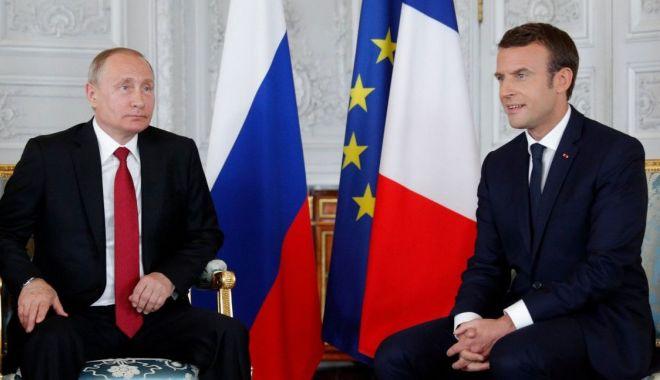 Foto: Putin şi Macron vor să consolideze eforturile pentru salvarea acordului nuclear iranian
