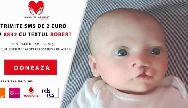 Foto: Ajută-l pe Robert să zâmbească! S-a născut cu o anomalie gravă a gurii