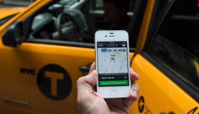 Foto: Românii, dezinteresaţi de aplicaţia de transport Uber